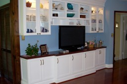 Spray lacquered cabinets, cherry counter, recessed lighting