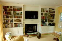 Spray lacquered wall unit and custom mantel