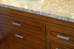 maple vanity with granite counter